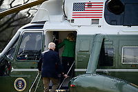 United States President Joe Biden and first lady Jill Biden board Marine One in Washington, D.C., U.S., on Friday, Feb. 26, 2021. Biden is visiting Texas today to discuss recovery efforts after winter weather caused widespread damage and left millions without power. <br /> Credit: Erin Scott / Pool via CNP /MediaPunch