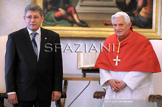 Pope Benedict XVI presented by Moldova's interim President Mihai Ghimpu (L) during a private visit at the Vatican May 24, 2010.