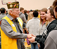 Janelle Jessen/Herald-Leader<br /> Students thank veteran Lawrence Lankford (left) for his service after the Veterans Day program at the Siloam Springs High School on Monday. Veterans of Foreign Wars Post 1674 and the high school partnered to host the program.