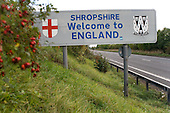 Road sign marking the border between England and Wales on the A5.