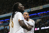 Bafetibis Gomis celebrates scoring his sides first goal during the Barclays Premier League Match between Manchester City and Swansea City played at the Etihad Stadium, Manchester on 12th December 2015. 1-1
