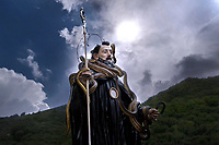 """A statue of Saint Domenico surrounded by live snakes is held up by worshippers during an annual procession dedicated to the saint, in the streets of Cocullo, in the Abruzzo region,May 1, 2019.<br /> <br /> <br /> <br /> The St. Domenico's procession in Cocullo, central Italy. Every year on the first  of May, snakes are placed onto the statue of St. Domenico and then the statue is carried in a procession through the town. St. Domenico is believed to be the patron saint for people who have been bitten by snakes:<br /> <br /> Italy, Cocullo, in the Province of L'Aquila, is at 870 meters, along the railway line connecting Sulmona to Rome. The village rises alongside Mount Luparo (1327 meters) """"The valley opening in front of the village is surrounded by bare rocks, while on the other side, to the south, snow-capped mountain crests follow one after the other...""""<br /> San Domenico Abate lived in the 10th and 11th centuries AD. Born in Foligno, in the Umbria region, he started his pilgrimages, preaching and ascetic practices in Central Italy, making miracles recorded by the word-of-mouth tradition. He died on 22 January 1031 and was buried in Sora.<br /> <br /> Cocullo snake charmers are over with their snake hunting. They proceeded through the During the procession on the first in May, before the snakes are placed all over the statue of St. Dominick, they will be fed with milk kept in containers with crusca. It is the snake that, most of all other elements, expresses an ancestral myth: the unknown aspect and unpredictability of the natural environment with man's innate need to achieve the dominance on his own habitat. <br /> <br /> Snakes and wolves were the emblems of Italic peoples like the Marsians and Irpinians. Some areas in Abruzzo, especially in the Sagittario valley, were under the menace of wolves and snakes, which for the local populations represented the uncertainty and anxiety of their existence that, together with the precariousness and hardships of life, wer"""