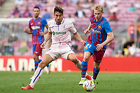 29th August 2021; Nou Camp, Barcelona, Spain; La Liga football league, FC Barcelona versus Getafe; Frenkie De Jong of FC Barcelona in action with Jaime Mata of Getafe CF