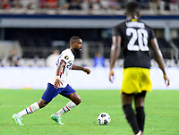 DALLAS, TX - JULY 25: Shaq Moore #20 of the United States looks to pass the ball during a game between Jamaica and USMNT at AT&T Stadium on July 25, 2021 in Dallas, Texas.