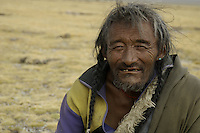 """Nomads near Namtso Lake.Namtso Lake :Namtso, another holy lake in Tibet, is located near Damxung. 4718 meters (15475 feet) above sea level and covering 1900 square kilometers (735 square miles), the lake is the highest saltwater lake in the world and the second largest saltwater lake in China. The snow capped Mt. Nyainqentanglha, considered as the son of Namtso and leader of sacred mountains, soars up to sky beside her. Singing streams converge into the clean sapphire blue lake, which looks like a huge mirror framed and dotted with flowers..The Namtso Lake is held as """"the heavenly lake"""" or """"the holy lake"""" in northern Tibet. .Respected as one of the three holiest lakes in Tibet, the Namtso Lake is the seat of Paramasukha Chakrasamvara for Buddhist pilgrims. In the fifth and sixth month of the Tibetan calendar each year, many Buddhists come to the lake pay homage and pray. Deep tracks are worn into the lakeshore due to this activity. In history, monasteries stood like trees in a forest around the site, attracting large numbers of pilgrims as eminent monks in Buddhist temples extended Buddhist teachings...Buddhists believe Buddhas, Bodhisattvas and Vajras will assemble to hold religious meeting at Namtso in the year of sheep on Tibetan calendar. It is said that walking around the lake at the right moment is 100,000 times more efficacious than that in normal years. That's why thousands of pilgrims from every corner of the world come to pray at the site, with the activity reaching a climax on Tibetan April 15...Walking around the lake takes a week. Ritual walkers love to burn aromatic plants to raise smoke on Auspicious Island [explain this a little] and throw a piece of hada scarf into the lake as a token of fulfilled wishes. If the scarf sinks, it implies ones wish is accepted by the Buddha; if the scarf flows on the water or only half sinks, it means one has failed to be honest and something unhappy may lie ahead...On the four sides of the lake stand four monasteries,"""