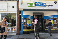 High Wycombe, England 20/04/2020 -<br /> People self distance in a queue outside a Cash & Cheque express shop in the town centre, High Wycombe during the COVID-19 pandemic lockdown as the UK Government advice to maintain social distancing and minimise time outside in High Wycombe on 20 April 2020. Photo by PRiME Media Images / Andy Rowland.