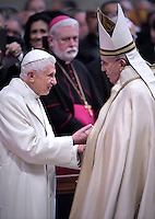 Pope Francis greets Pope Benedict XVI Emeritus, during a consistory for the creation of new Cardinals at St. Peter's Basilica in Vatican.February 14, 2015