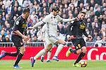 Alvaro Morata of Real Madrid competes for the ball with David Lopez and Javi Fuego during the match of La Liga between Real Madrid and RCE Espanyol at Santiago Bernabeu  Stadium  in Madrid , Spain. February 18, 2016. (ALTERPHOTOS/Rodrigo Jimenez)