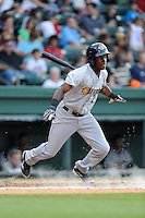 Shortstop Jorge Mateo (2) of the Charleston RiverDogs bats in a game against the Greenville Drive on Monday, June 29, 2015, at Fluor Field at the West End in Greenville, South Carolina. Greenville won, 4-2. (Tom Priddy/Four Seam Images)
