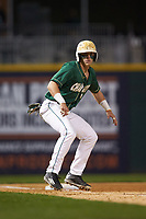 Brett Netzer (9) of the Charlotte 49ers takes his lead off of third base against the Georgia Bulldogs at BB&T Ballpark on March 8, 2016 in Charlotte, North Carolina. The 49ers defeated the Bulldogs 15-4. (Brian Westerholt/Four Seam Images)