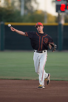 AZL Giants Black second baseman Marcos Campos (15) makes a throw to first base during an Arizona League game against the AZL Athletics at the San Francisco Giants Training Complex on June 19, 2018 in Scottsdale, Arizona. AZL Athletics defeated AZL Giants Black 8-3. (Zachary Lucy/Four Seam Images)