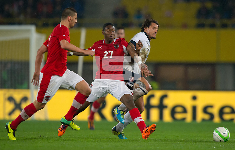 VIENNA, Austria - November 19, 2013: Jermaine Jones and Austria's David Alaba during a 0-1 loss to host Austria during the international friendly match between Austria and the USA at Ernst-Happel-Stadium.