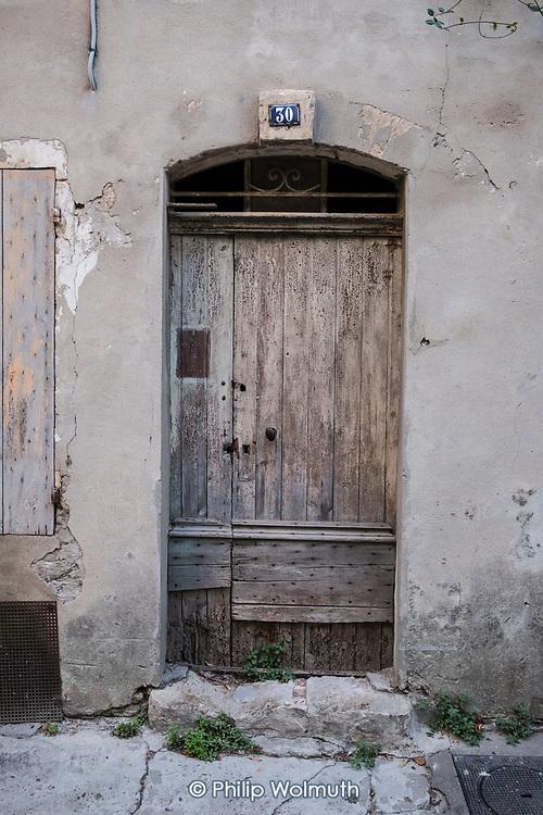 Doorway number 30 in a street in Arles, France.