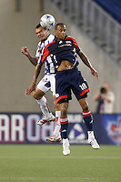 Pachuca CF defender Julio Cesar Manzur (3) and New England Revolution midfielder Khano Smith (18) go up for a header. The New England Revolution defeated Pachuca CF 1-0 during a Group B match of the 2008 North American SuperLiga at Gillette Stadium in Foxborough, Massachusetts, on July 16, 2008.
