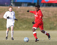 St. Lawrence forward Jamal Samaroo (7) brings the ball forward.  NCAA Division III Sectionals. In double-overtime, Amherst College (white) defeated St. Lawrence University (red), 2-1, on Hitchcock Field at Amherst College on November 23, 2013.