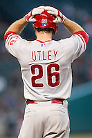 Philadelphia Phillies second baseman Chase Utley #26 reacts to being denied a hit by Astros outfielder Jimmy Paredes during the Major League baseball game against the Houston Astros on September 16th, 2012 at Minute Maid Park in Houston, Texas. The Astros defeated the Phillies 7-6. (Andrew Woolley/Four Seam Images).