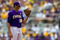 LSU Tigers pitcher Kevin Gausman #12 looks in for the catchers sign during the NCAA Super Regional baseball game against Stony Brook on June 9, 2012 at Alex Box Stadium in Baton Rouge, Louisiana. Stony Brook defeated LSU 3-1. (Andrew Woolley/Four Seam Images)