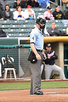 Home plate umpire Scott Mahoney (4) during the game as the Salt Lake Bees played the Sacramento River Cats at Smith's Ballpark on April 3, 2014 in Salt Lake City, Utah.  (Stephen Smith/Four Seam Images)