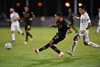 LAKE BUENA VISTA, FL - JULY 18: Eddie Segura #4 of LAFC passes the ball while  pressured by Cristian Pavón #10 of LA Galaxy during a game between Los Angeles Galaxy and Los Angeles FC at ESPN Wide World of Sports on July 18, 2020 in Lake Buena Vista, Florida.
