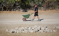 Pictured: An offcer with a wheel barrow from the site where the farmhouse extension used to be in Kos, Greece. Thursday 06 October 2016<br />