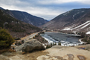 Franconia Notch State Park from Artists Bluff in the New Hampshire White Mountains on a snowless and cloudy February day during the winter of 2016.