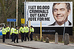 © Joel Goodman - 07973 332324 - all rights reserved . 03/04/2010 . Dudley , UK . Police in the town , overshadowed by Conservative Party election posters featuring the smiling face of Gordon Brown . The English Defence League ( EDL ) hold a demonstration in Dudley , opposed by Unite Against Fascism ( UAF ) . Photo credit : Joel Goodman