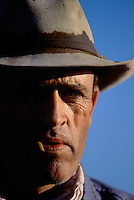 Portrait of a working cowboy watching his cattle on the ranch in Northern California.