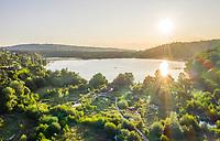 France, Puy de Dome, Volcans d'Auvergne Regional Natural Park, Aydat, Aydat lake at sunrise (aerial view) // France, Puy-de-Dôme (63), Parc naturel régional des volcans d'Auvergne, Aydat, lac d'Aydat au soleil levant (vue aérienne)
