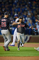 Cleveland Indians third baseman Michael Martinez (center) celebrates with teammates, including first baseman Mike Napoli (26), after closing out Game 3 of the Major League Baseball World Series against the Chicago Cubs on October 28, 2016 at Wrigley Field in Chicago, Illinois.  (Mike Janes/Four Seam Images)