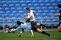 US Womens's National Team Goalkeeper Hope Solo dives to save a shot vs Germany in the 2010 Algarve Cup Final vs Germany. The US won 3-2 in the game in Faro, Portugal.