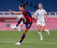 SAITAMA, JAPAN - JULY 24: Christen Press #11 of the USWNT takes a shot during a game between New Zealand and USWNT at Saitama Stadium on July 24, 2021 in Saitama, Japan.