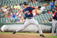 Tacoma Rainiers starting pitcher Andrew Carraway (34)  delivers a pitch to the plate against the Salt Lake Bees in Pacific Coast League action at Smith's Ballpark on July 9, 2014 in Salt Lake City, Utah.  (Stephen Smith/Four Seam Images)