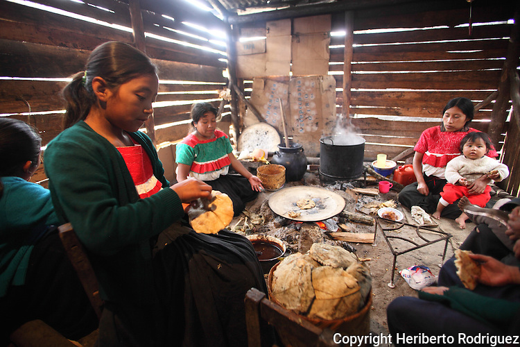 A Native nahuatl family prepares tamales in their village of Acaxochitlan village, in northern state of Hidalgo, during the festivities of the Day of the Deads. Hundreds of Native villages pay homage to their deads on the eve of November 2 as a tradition since the preHispanic times. Photo by Heriberto Rodriguez