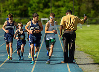 Sports action photography of the Woodlawn School track team in action at their meet at  Victory Christian School in Charlotte, NC.<br /> <br /> <br /> Charlotte Photographer - PatrickSchneiderPhoto.com