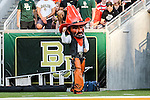 The OSU mascot in action during the game between the Oklahoma State Cowboys and the Baylor Bears at the McLane Stadium in Waco, Texas.
