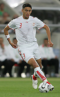 Karim Haggui (3) of Tunisia. Spain defeated Tunisia 3-1 in their FIFA World Cup Group H match at the Gottlieb-Daimler-Stadion, Stuttgart, Germany, June 19, 2006.
