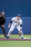 Michigan Wolverines first baseman Jimmy Kerr (15) on defense in the NCAA baseball game against the Michigan State Spartans on May 7, 2019 at Ray Fisher Stadium in Ann Arbor, Michigan. Michigan defeated Michigan State 7-0. (Andrew Woolley/Four Seam Images)