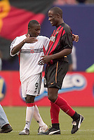 D.C. United's Freddy Adu chats with the MetroStars' Tenywa Bonseu after the game. DC United were defeated by the NY/NJ MetroStars 3 to 2 during the MetroStars home opener at Giant's Stadium, East Rutherford, NJ, on April 17, 2004.