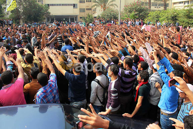 Al-Azhar University students supporters of the Muslim Brotherhood and ousted Egyptian President Mohamed Mursi, shout slogans during a march against Egypt's new military rulers, at Al-Azhar University in Cairo on Dec.18, 2013. Photo by Mohammed Bendari