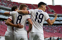 ZAPOPAN, MEXICO - MARCH 21: Hassani Dotson #18, Djordje Mihailovic #8 and Sebastian Soto #19 of the United States celebrate a Dotson goal during a game between Dominican Republic and USMNT U-23 at Estadio Akron on March 21, 2021 in Zapopan, Mexico.