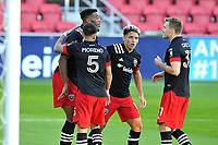 WASHINGTON, DC - NOVEMBER 8: Donovan Pines #23 of D.C. United celebrates his score with teammates during a game between Montreal Impact and D.C. United at Audi Field on November 8, 2020 in Washington, DC.