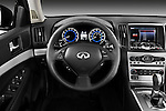 Steering wheel view of a 2011 Infiniti G25 Journey Sedan