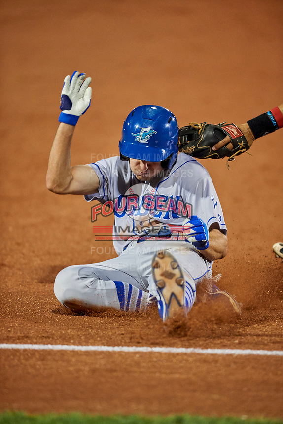 Kevin Lachance (5) of the Ogden Raptors slides into third base and is tagged for the out during the game against the Orem Owlz at Home of the Owlz on September 11, 2017 in Orem, Utah. Ogden defeated Orem 7-3 to win the South Division Championship. (Stephen Smith/Four Seam Images)
