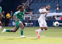 KANSAS CITY, KS - JUNE 26: Daniel Kadell #3 pursues Shahdon Winchester #9 during a game between Guyana and Trinidad
