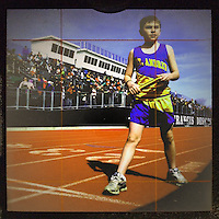 Young boy runner at track meet shot with an iPhone 3Gsprocessed with various photo editing apps on the phone for different interpretations of the image.