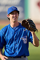 Dunedin Blue Jays pitcher Nick Frasso (26) warms up in the outfield before a game against the Clearwater Threshers on May 20, 2021 at BayCare Ballpark in Clearwater, Florida.  (Mike Janes/Four Seam Images)