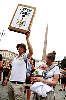 A man with his wife and child, shows a banner that symbolize that the Green pass is like the David star sewn on the clothes of the jews in nazi-fascism times, during the demonstration against the green pass, that certifies the vaccination against covid 19, after the last decree of the council of ministers, necessary to enter public places, such as offices, schools but also restaurants..<br /> Rome (Italy), July 27th 2021<br /> Photo Samantha Zucchi Insidefoto