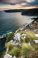 Southern views of Pacific Ocean along coastline from Nugget Point at sunset, Catlins, Southland, New Zealand