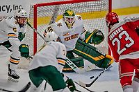 29 December 2018: University of Vermont Catamount Goaltender Stefanos Lekkas, a Junior from Elburn, IL, makes a third period save against Rensselaer Engineer Defenseman Jake Johnson, a Freshman from Bloomington, MN, at Gutterson Fieldhouse in Burlington, Vermont. The Catamounts rallied from a 2-0 deficit to defeat RPI 4-2 and win the annual Catamount Cup Tournament. Mandatory Credit: Ed Wolfstein Photo *** RAW (NEF) Image File Available ***