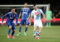 Calcio, Serie A: Napoli, stadio San Paolo, 2 aprile, 2017.<br /> Napoli's Marek Hamsik (r) in action with Juventus Claudio Marchisio (l) during the Italian Serie A football match between Napoli and Juventus at San Paolo stadium, April 2, 2017<br /> UPDATE IMAGES PRESS/Isabella Bonotto